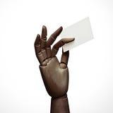 Dark wood hand holding business card Stock Photo