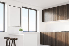 Dark wood kitchen corner with a table Royalty Free Stock Images