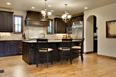 Dark Wood Kitchen With Granite Counters Royalty Free Stock Images