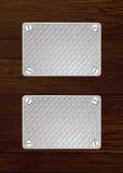 Dark wood metal plate Royalty Free Stock Images