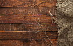 Dark wood with old burlap texture, top view Stock Photography
