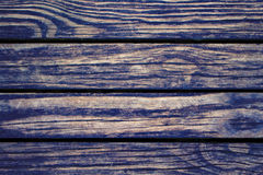 Dark wood planks closeup. Rough lumber surface. Warm brown wooden background for vintage card. Royalty Free Stock Image