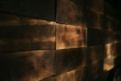 Dark wood planks stacked to a pile Royalty Free Stock Image