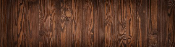Dark wood texture, blank background of a brown wooden table or f royalty free stock images