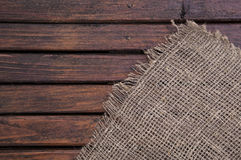 Dark wood texture and fabric. Royalty Free Stock Image