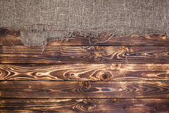 Dark wooden background with burlap, rustic wood and sack Stock Images