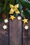 Dark wooden background with fir branches and decorations Royalty Free Stock Image