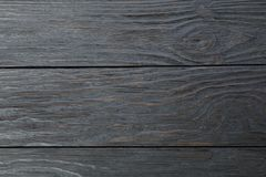 Dark wooden background. Space for text. Closeup stock photography