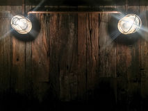 Dark wooden background texture, grunge industrial interior with. Grunge industrial wooden interior room with classic Edison light bulb royalty free stock image