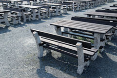 Dark wooden bench in open air restaurant Stock Photography