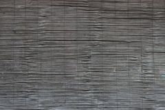 Dark wooden blinds texture. Dark and old wooden blinds texture or pattern in back of window royalty free stock photo