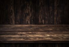 Dark wooden table for product, old black wooden perspective interior. Dark wooden board table for product display montage, black wooden perspective interior Royalty Free Stock Images