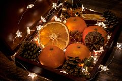Lights, cone, mandarins, Christmas party, traditions, home evening stock image