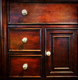 Dark wooden chest of drawers Stock Photo