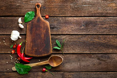 Dark wooden culinary background with various herbs and spices, top view, rustic Stock Photos