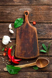Dark wooden culinary background with various herbs and spices, top view, rustic Royalty Free Stock Photo