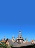 Banner church orthodox russia vertical. Dark wooden cupola vertical banner. Triangular  black dark wood cupola with crosses of an orthodox temple against the Royalty Free Stock Photography