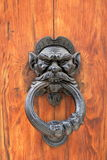 Dark wooden door with black dusty handle Stock Photography