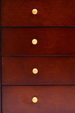 Dark wooden drawers Royalty Free Stock Images