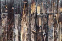 Dark wooden fence. Abstract background of dark brown wooden fence Stock Photography