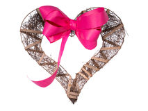 Dark wooden handmade heart and ribbon on a white background Royalty Free Stock Photography