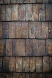 Dark wooden panelling. Dark wooden tiles overlap to form a rustic background Stock Image