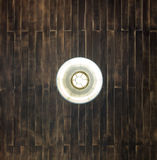 Dark wooden plank ceiling with hanging lamp Royalty Free Stock Photos