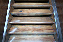 Dark wooden stairs isolated. Section of a dark worn wooden stairway Royalty Free Stock Images