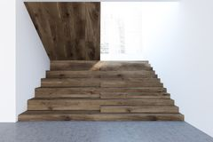 Dark wooden stairs in a white wall hall, picture. Wooden stairs in a white wall hall of a luxury house or office interior with a concrete floor and a cityscape Stock Photo