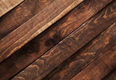 Dark wooden texture. Diagonal background brown old wood planks. Royalty Free Stock Photos