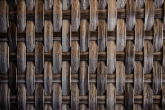 Dark wooden texture of rattan with natural patterns Stock Image
