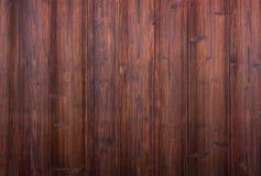 Dark wooden wall background. Dark brown wooden plank wall texture background royalty free stock photo