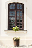 Dark wooden window in the wall of the palace. Royalty Free Stock Images