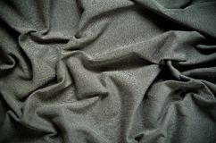 Dark wrinkled fabric texture. Stock Image