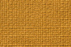 Dark yellow background from a textile material. Fabric with natural texture. Backdrop. Stock Photo
