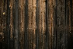 Dark yellow and gray shabby wood background. Old wall wooden vintage floor. Texture backdrop. Rough structure. Black yellow patter stock image