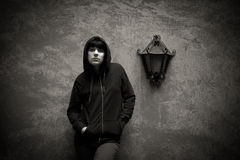 Dark young woman sad standing near urban wall black and white Royalty Free Stock Photography