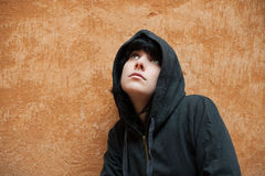 Dark young woman sad standing near urban wall portrait Royalty Free Stock Images