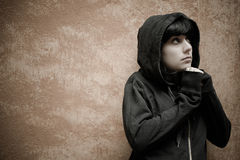Dark young woman sad standing near urban wall portrait Royalty Free Stock Photo