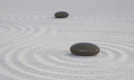 Dark Zen stones on white sand Stock Photo