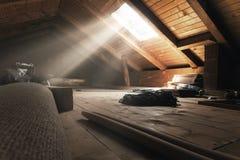 Darken attic with light rays at window. Darken attic room with light rays at window Stock Image