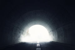 Darken tunnel with fog. And light at the end of tunnel Royalty Free Stock Photography