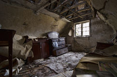 Darkened Abandonment. A neglected room in a rural cottage Stock Image