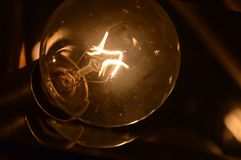 Darkened Light. Close dark view of a light bulb Stock Photos