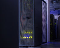 Darkened room with rows of modern server hardware Stock Images
