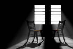 Two Empty Chairs in a Darkened Room Stock Images