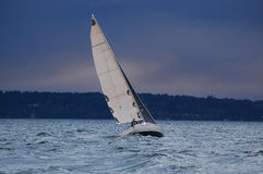 Darkened skies, rough seas, heading for home. Royalty Free Stock Photography