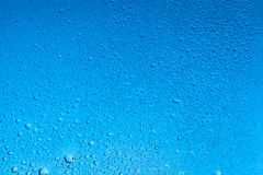 Darker light blue water drops abstract background Royalty Free Stock Photography