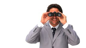 Darkhaired man looking at something stock footage