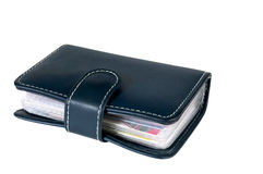 The darkly blue leather wallet with credit cards inside. On white background Stock Photo